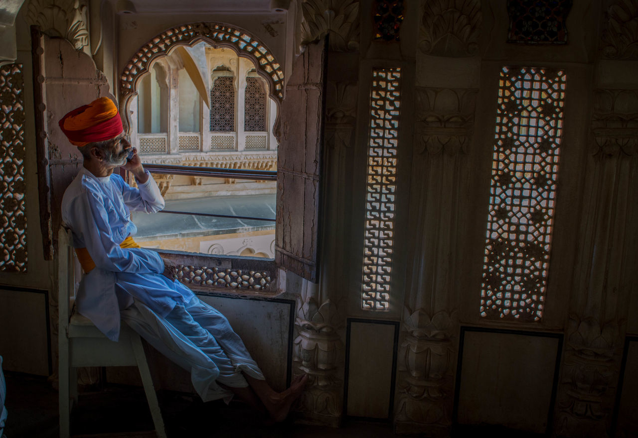 One Person Adult People Travel Destinations Individuality Full Length Indoors  Portrait Day Indian Culture  Indian Culture  Indian Culture  India Rajasthan Mehrangarhfort Mehrangarh Jodhpur Fort Jodhpur Rajasthan Jodhpur Fort Old Building  Old Buildings Indoors  Oldman Low Angle View TCPM