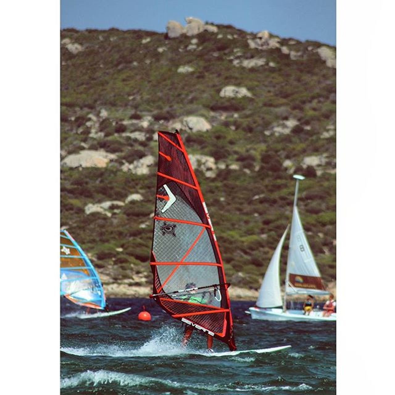 I can fly. Do you believe me?🐲 //Porto pollo, Sardinia Windsurf Surf Portopollo Isoladeigabbiani Red Wind Waves Summer Hot Waterman Watersport Sardegna Sup Eagle Missthis Power Strong Fun Sport Canon Gopro Squareinstapic @studio8apps