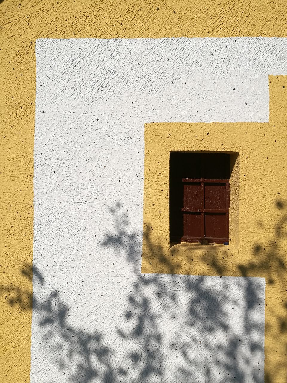 wall - building feature, built structure, architecture, shadow, yellow, building exterior, day, sunlight, outdoors, window, textured, no people, close-up