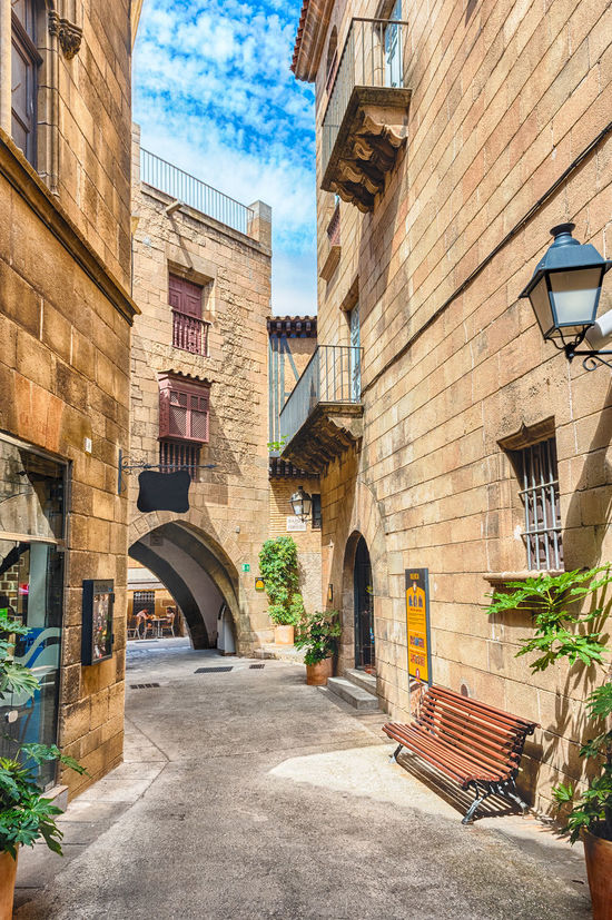 Scenic alley inside Poble Espanyol, an open-air architectural museum on the Montjuic hill in Barcelona, Catalonia, Spain Barcelona Poble Espanyol PobleEspanyol Architecture Building Exterior Built Structure Day No People Outdoors Poble Sky