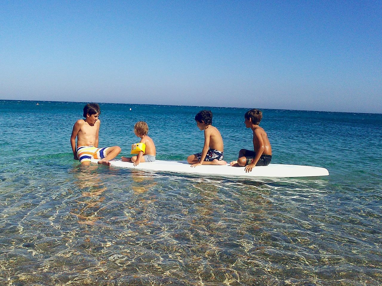 Relaxing till the next wave. Surf Surfing Children Kids Fun Boys Funtime Karpathos Greece Dodecanese Travel Sea Sports