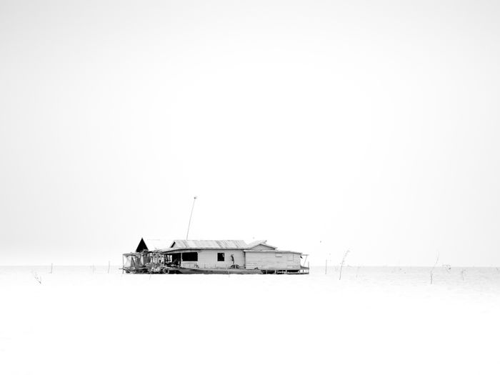 Beauty In Nature Cold Temperature Copy Space Day Floating Floating House Lake Monochrome Photography Nature No People Non-urban Scene Outdoors Remote Scenics Sea Snow Solitude Tranquil Scene Tranquility