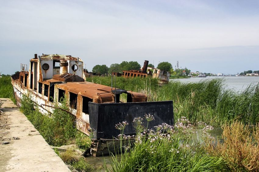 Danube DanubeDelta Sulina WreckedShip Abandoned Damaged Danube România Danube Delta ,romania Danube River Day Grass Nature No People Old Outdoors Rusty Sky Water Wrecked Wrecked Boat. The Week On EyeEm