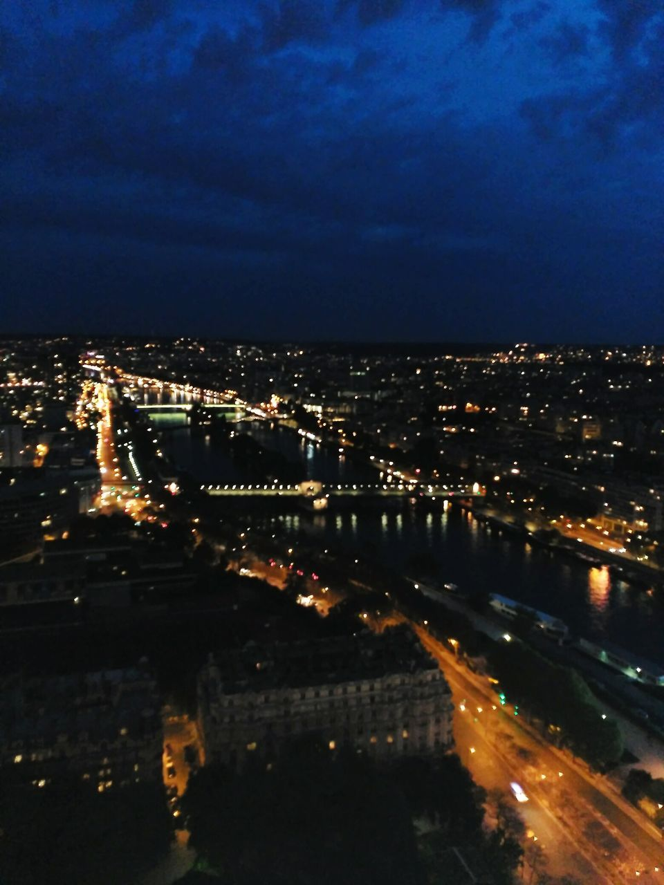 illuminated, city, night, cityscape, architecture, connection, no people, modern, built structure, building exterior, outdoors, chain bridge, sky