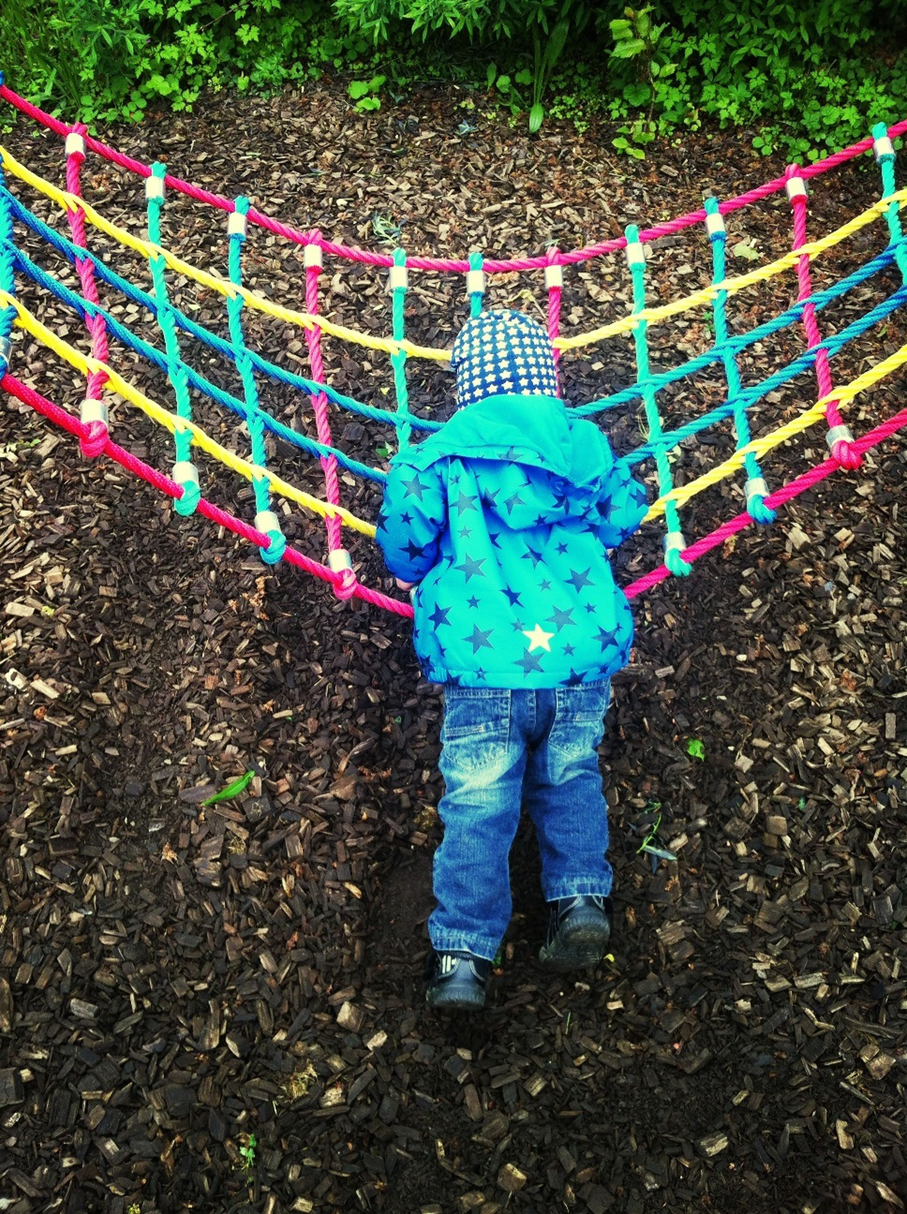 childhood, full length, elementary age, girls, boys, casual clothing, lifestyles, leisure activity, standing, innocence, holding, high angle view, playful, toy, cute, rear view, park - man made space, multi colored