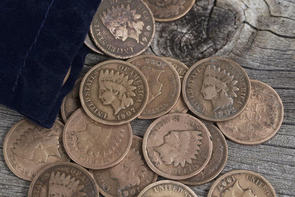 Bag of old American Cents on rustic wood Cent Circle Close-up Coin Collection Currency Day Finance Financial Item Gold Colored Human Representation Indian Head Indoors  Large Group Of Objects Metal Money Neat No People Number Penny Rare Savings Text Vintage Wealth