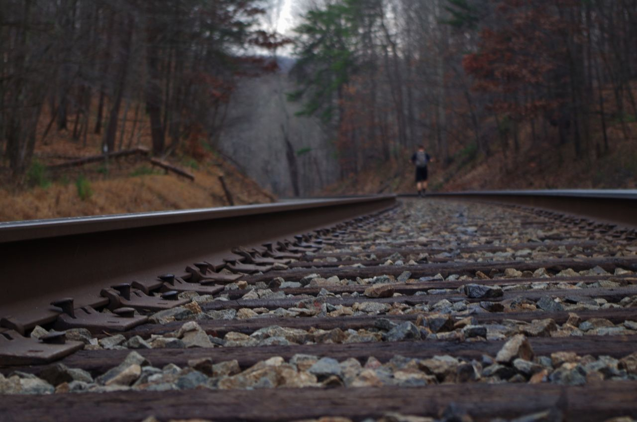 Rear View Of Man On Railroad Track
