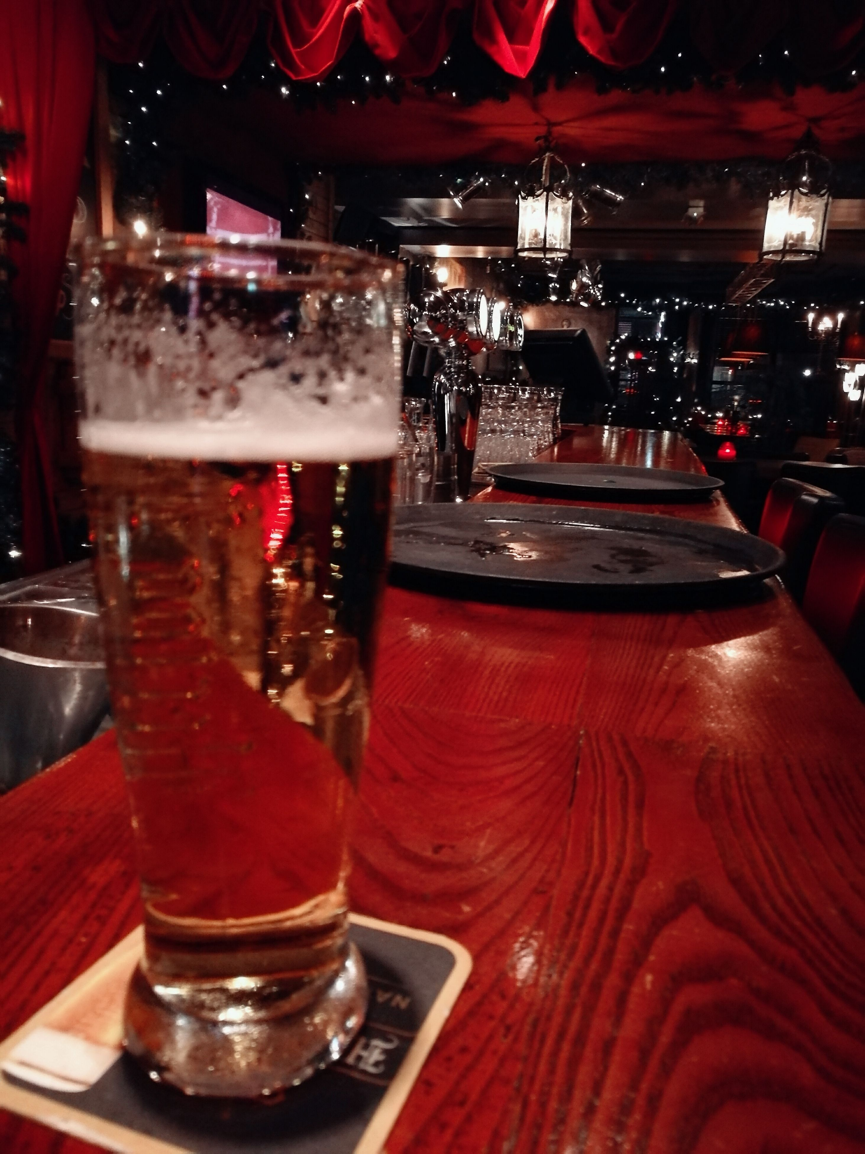 alcohol, drink, indoors, red, food and drink, table, bar - drink establishment, drinking glass, nightclub, nightlife, refreshment, illuminated, freshness, no people, wine, bar, night, hard liquor, wine rack