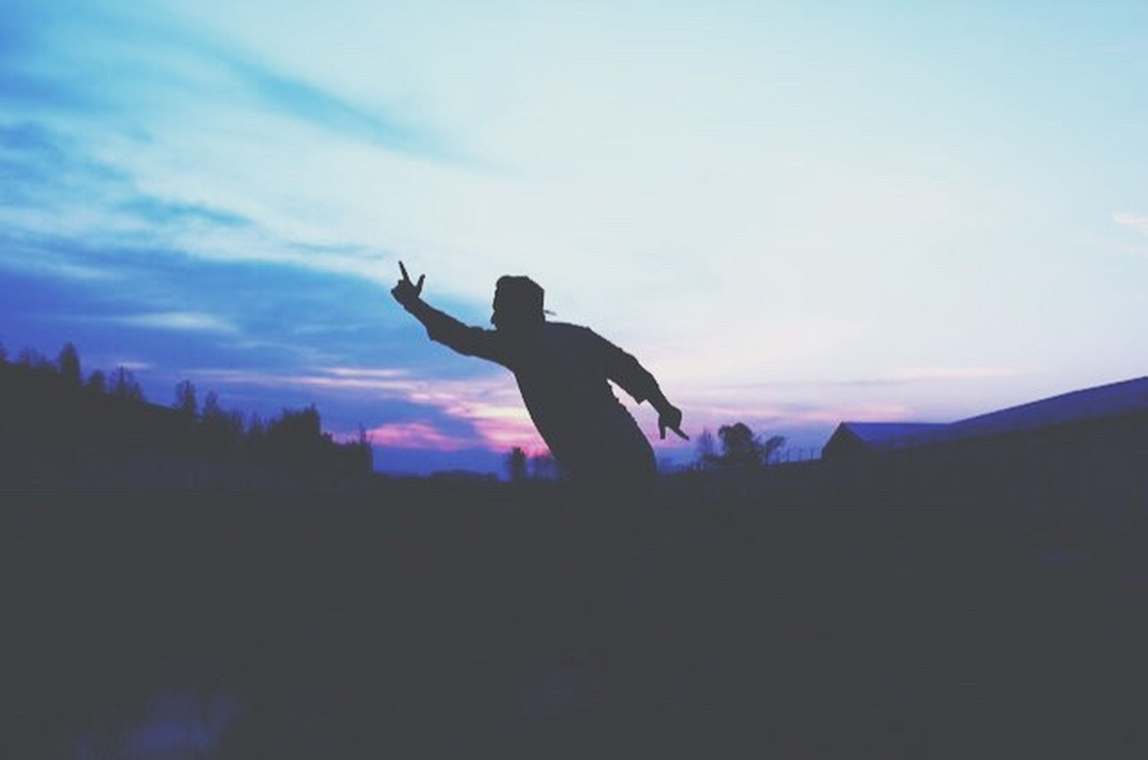 silhouette, lifestyles, sky, leisure activity, sunset, arms raised, full length, mid-air, men, low angle view, jumping, dusk, freedom, arms outstretched, cloud - sky, carefree, enjoyment, standing
