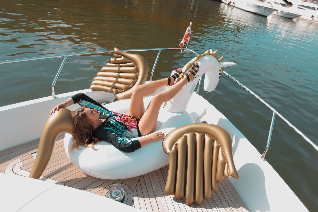 Beautiful girl relaxing on the yacht in Sardinia Bestoftheday Blue Sea Champagne Costa Smeralda Floating On Water Girl Holiday Inflatable  Italia Italy Lifestyle Luxury Model Ocean Paradise Pegasus Pool Relaxation Sardegna Sardinia Swimming Toy Unicorn Water Yacht