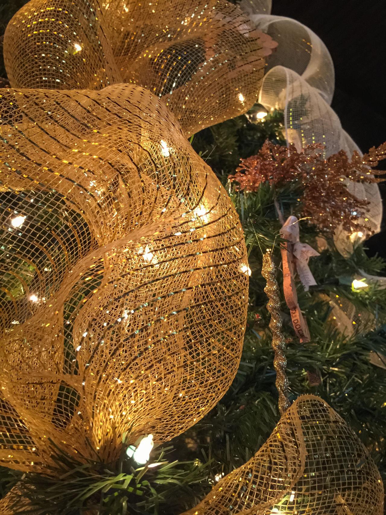 Gold ribbon and christmas tree lights Celebration Christmas Christmas Decoration Christmas Lights Christmas Lights Christmas Ornament Christmastime Close-up Gold Ribbon Illuminated Lacy Day Night No People