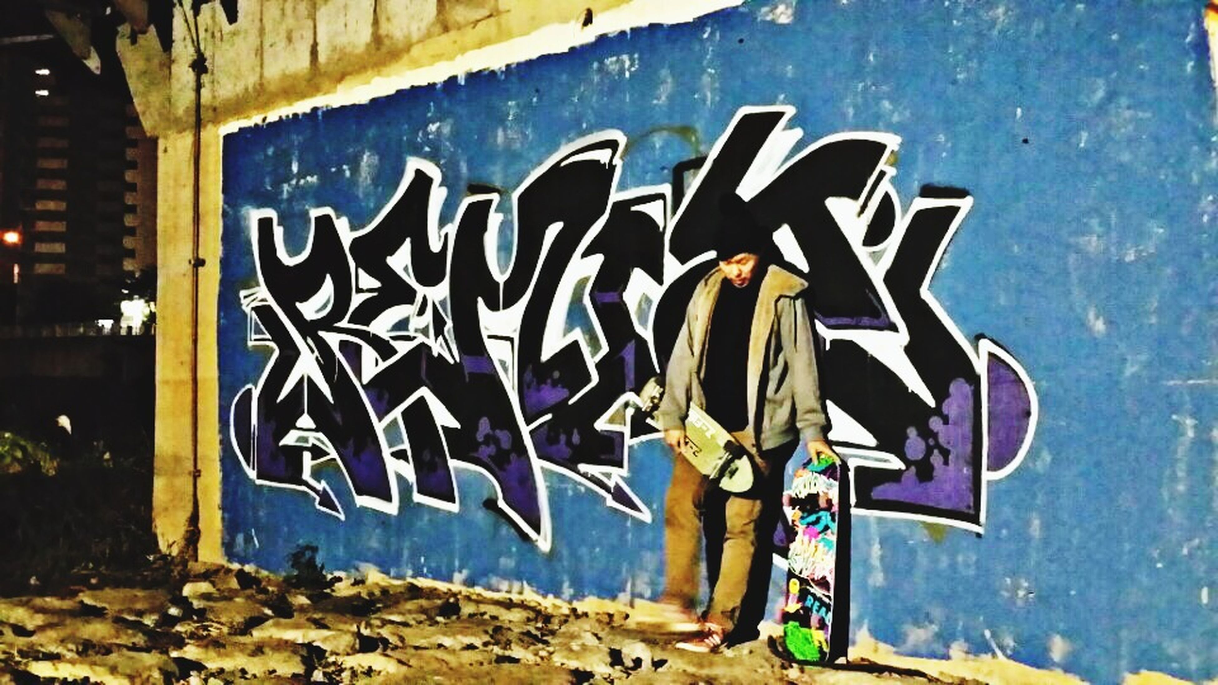 graffiti, creativity, art, art and craft, wall - building feature, built structure, blue, architecture, building exterior, wall, text, no people, outdoors, day, communication, street art, close-up, human representation, western script, multi colored