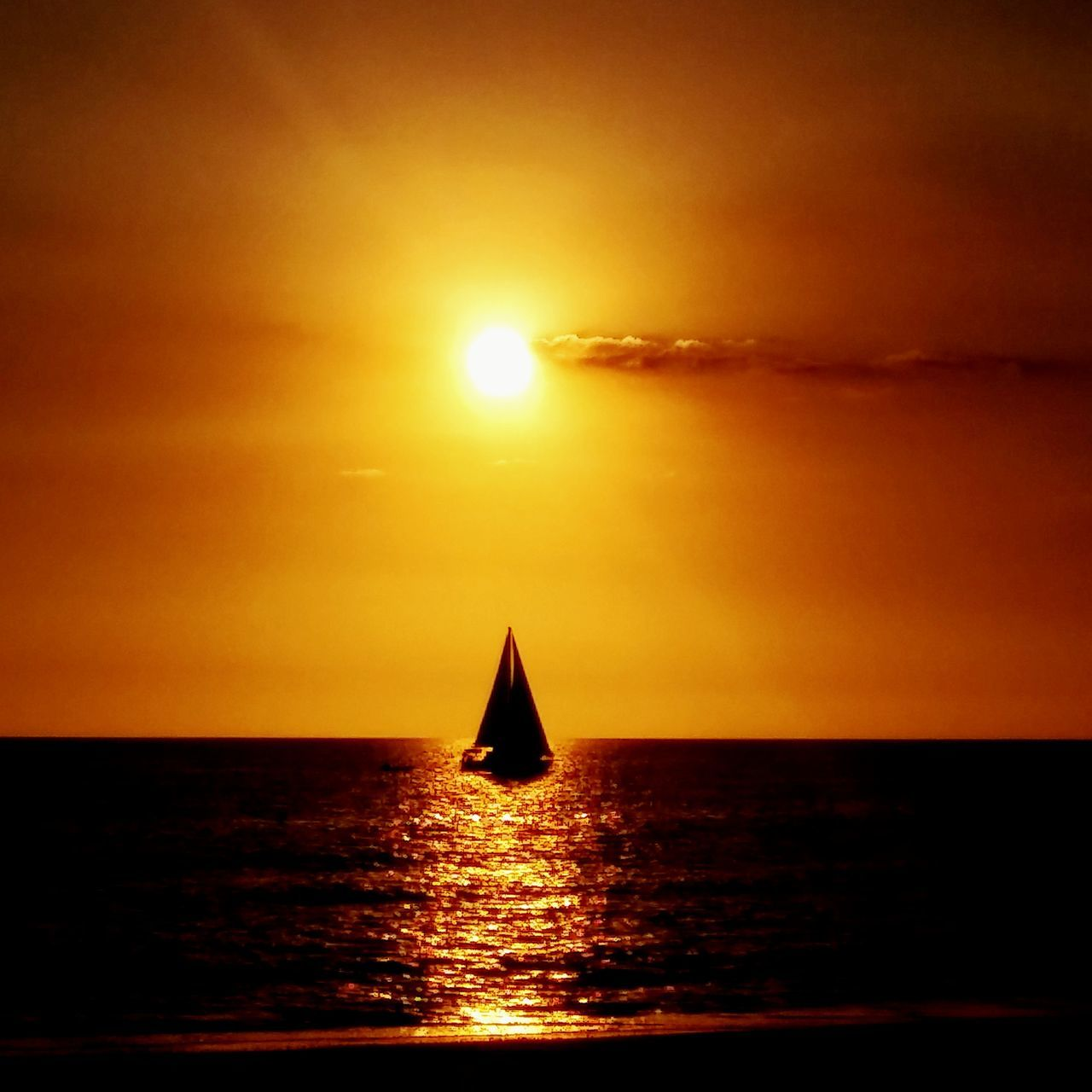 sunset, sun, orange color, sea, silhouette, beauty in nature, water, scenics, sunlight, sky, reflection, nature, tranquility, no people, tranquil scene, outdoors, waterfront, nautical vessel, horizon over water, day