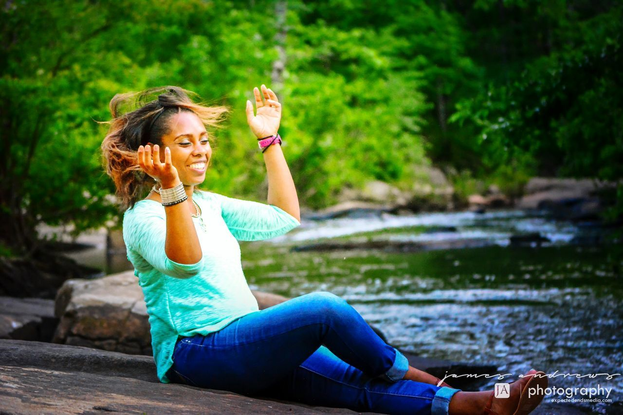water, outdoors, real people, sitting, one person, lifestyles, drinking, beauty in nature, full length, leisure activity, beautiful woman, lake, nature, young adult, young women, day, tree, portrait, adult, people