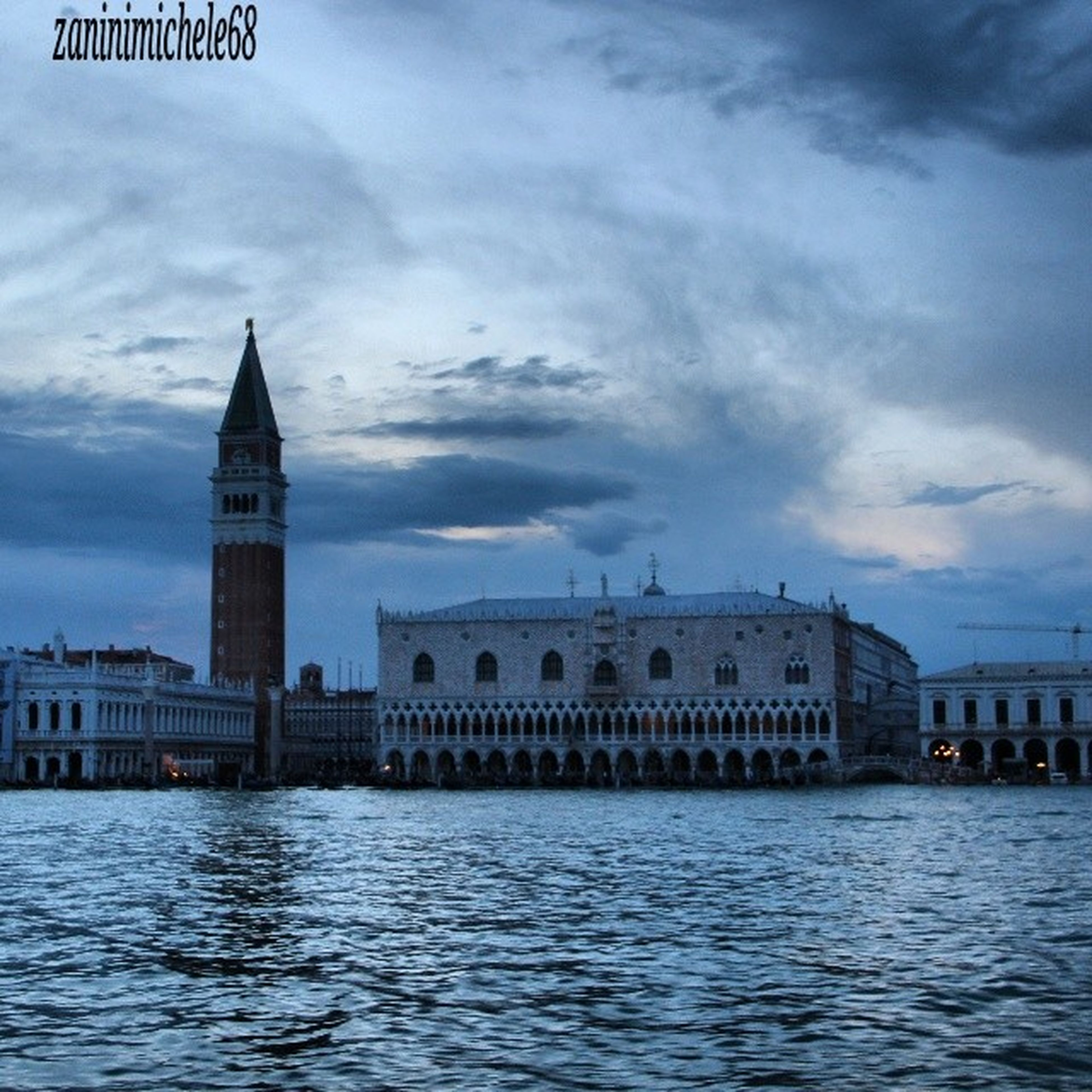 architecture, building exterior, built structure, waterfront, water, sky, cloud - sky, river, rippled, cloudy, city, cloud, church, travel destinations, religion, day, outdoors, history, famous place