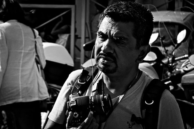 Contemplation. Black And White Black People Candid Candid Photography Candid Portraits City Life Front View Gear Holding Monochrome Photography Outdoors Person Photographer Photographic Equipment Rome Tourist