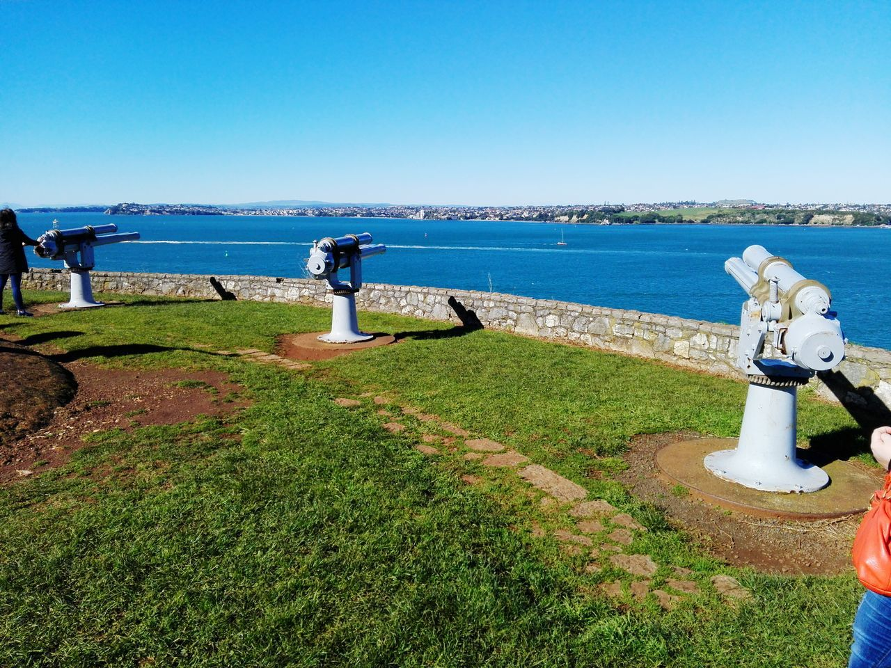 water, sea, blue, day, clear sky, nature, horizon over water, beauty in nature, scenics, outdoors, grass, tranquil scene, no people, statue, sunlight, sky