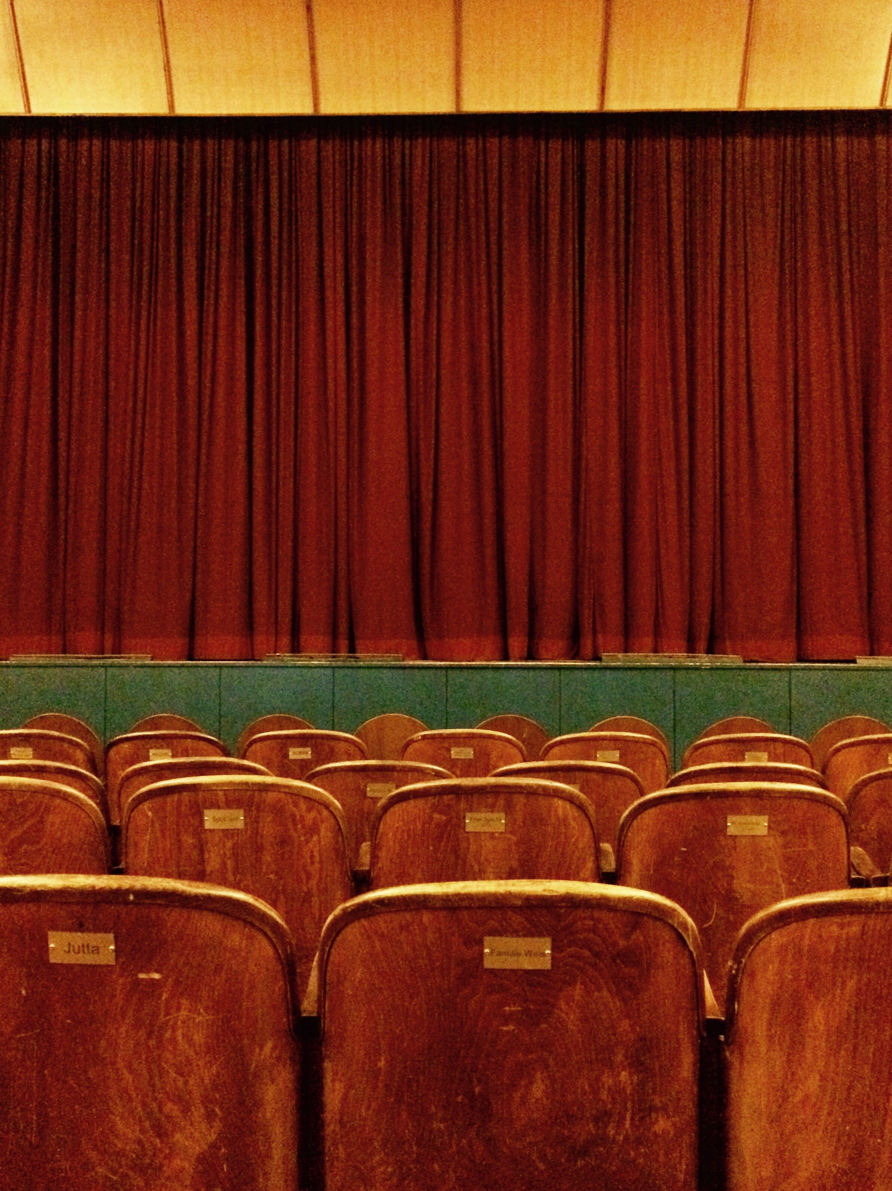 red, arts culture and entertainment, seat, in a row, auditorium, no people, backgrounds, indoors, film industry, day