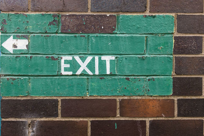 Painted Exit sign on brick wall Arrow Backgrounds Brick Brick Wall Brick Wall Communication Concrete Day Exit Exit Sign Full Frame Green Green Color Multi Colored No People Outdoors Paint Paving Stone Signs Text Wall Wall - Building Feature Western Script