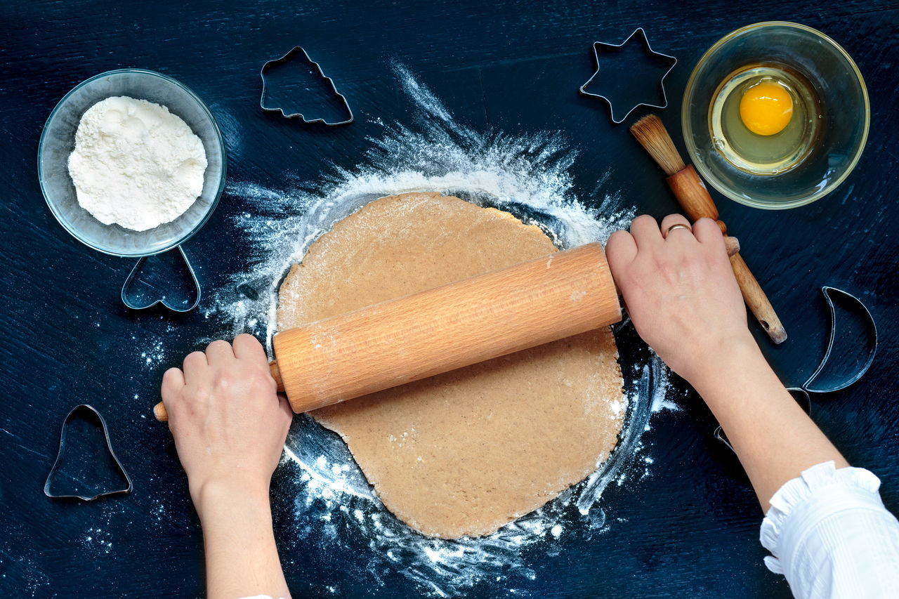 Woman making dough for a Christmas cookies Baking Cake Christmas Cookie Cooking Cute Cutter Dough Egg Female Flour Gingerbread Girl Hands Homemade Indoors  Making Making Music Person Preparation  Rollingpin Table Top View Woman
