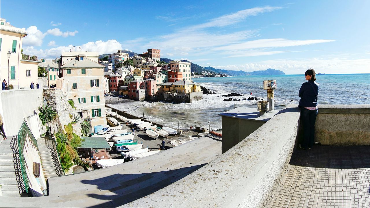 Miles Away in Genova, Italy Real People Sky Sunlight Full Length Leisure Activity Cloud - Sky Outdoors People Women Adult Water Day Adults Only City Architecture One Person Nature Young Adult Open Edit Eye4photography  EyeEm Best Shots Fresh 3 Travel Destinations Lieblingsteil