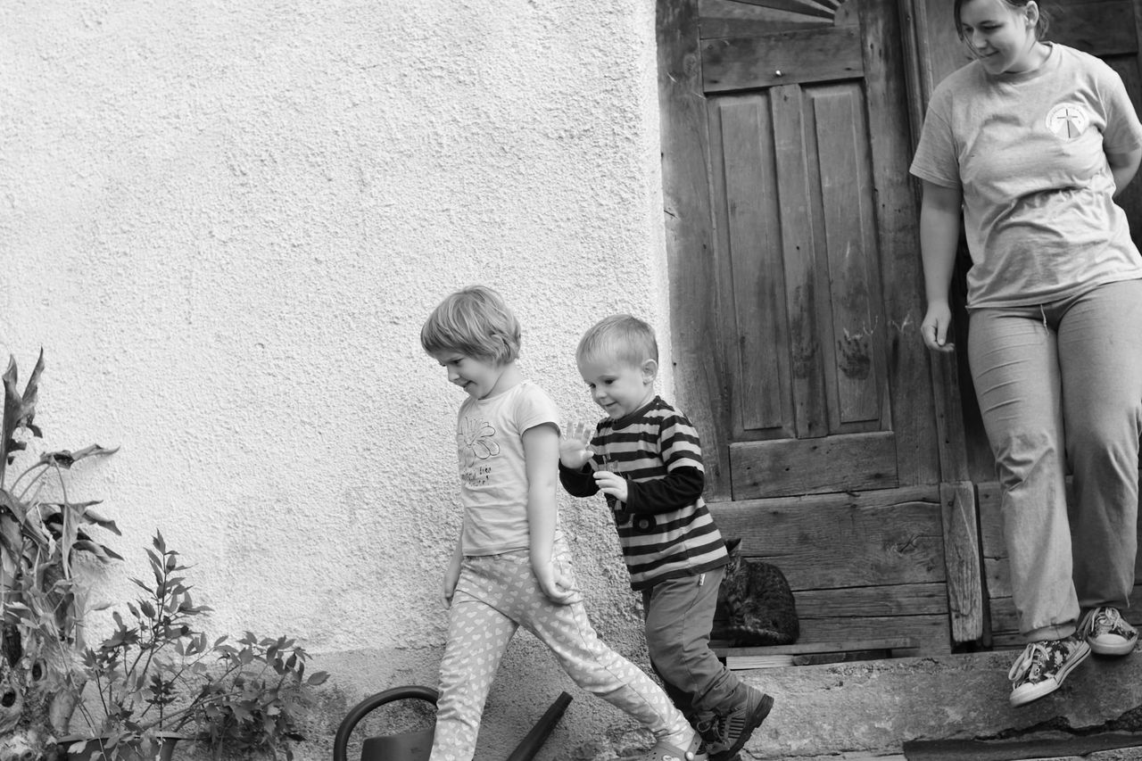 Enjoy The New Normal Childhood Playing Outdoors Togetherness Brother & Sister Having Fun Enjoyin Summer Old House Playing Outside Playing Outdoors Day Black & White Blackandwhite Photography