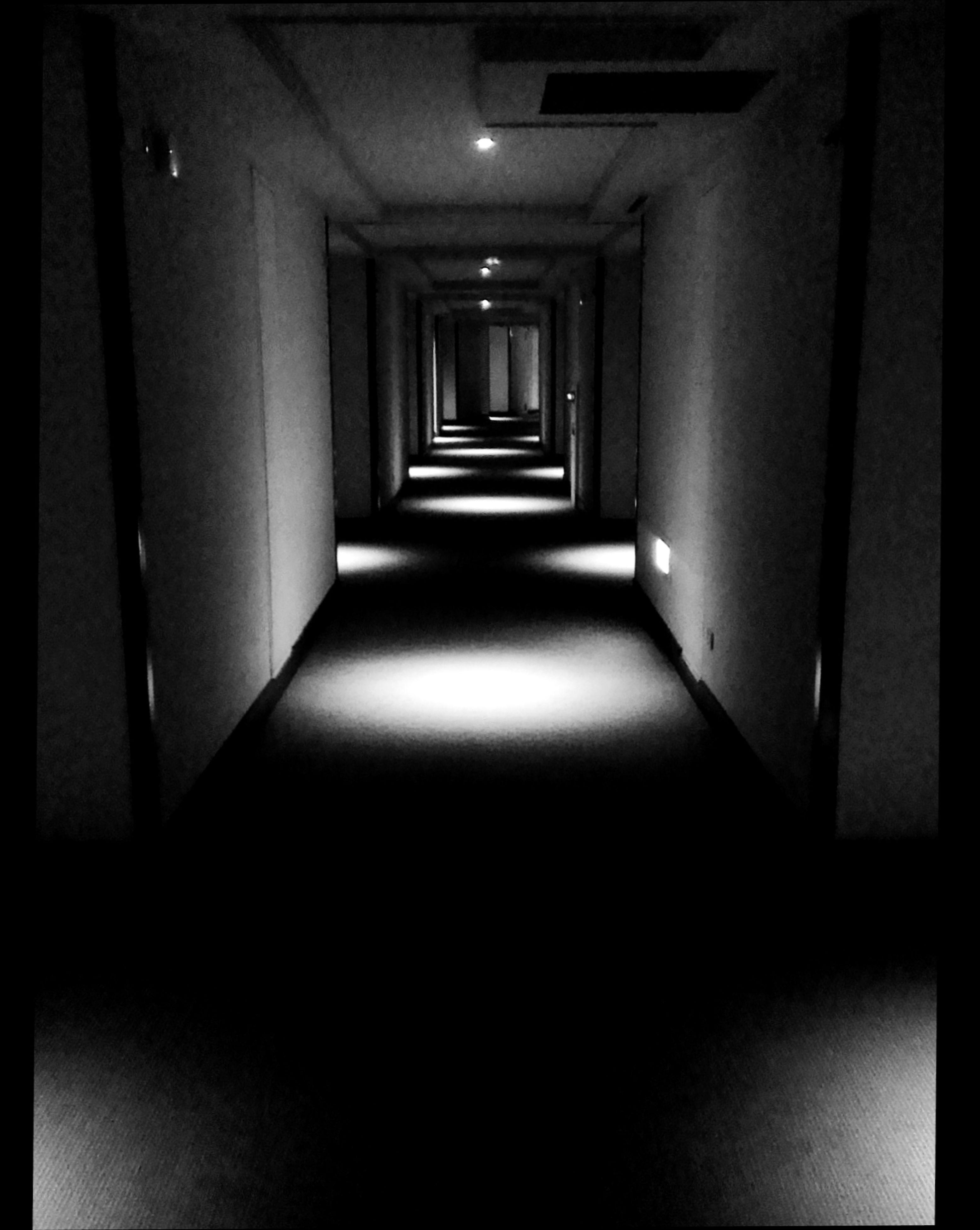 the way forward, indoors, architecture, corridor, built structure, diminishing perspective, empty, narrow, absence, vanishing point, wall - building feature, door, wall, building, illuminated, no people, long, doorway, sunlight, walkway