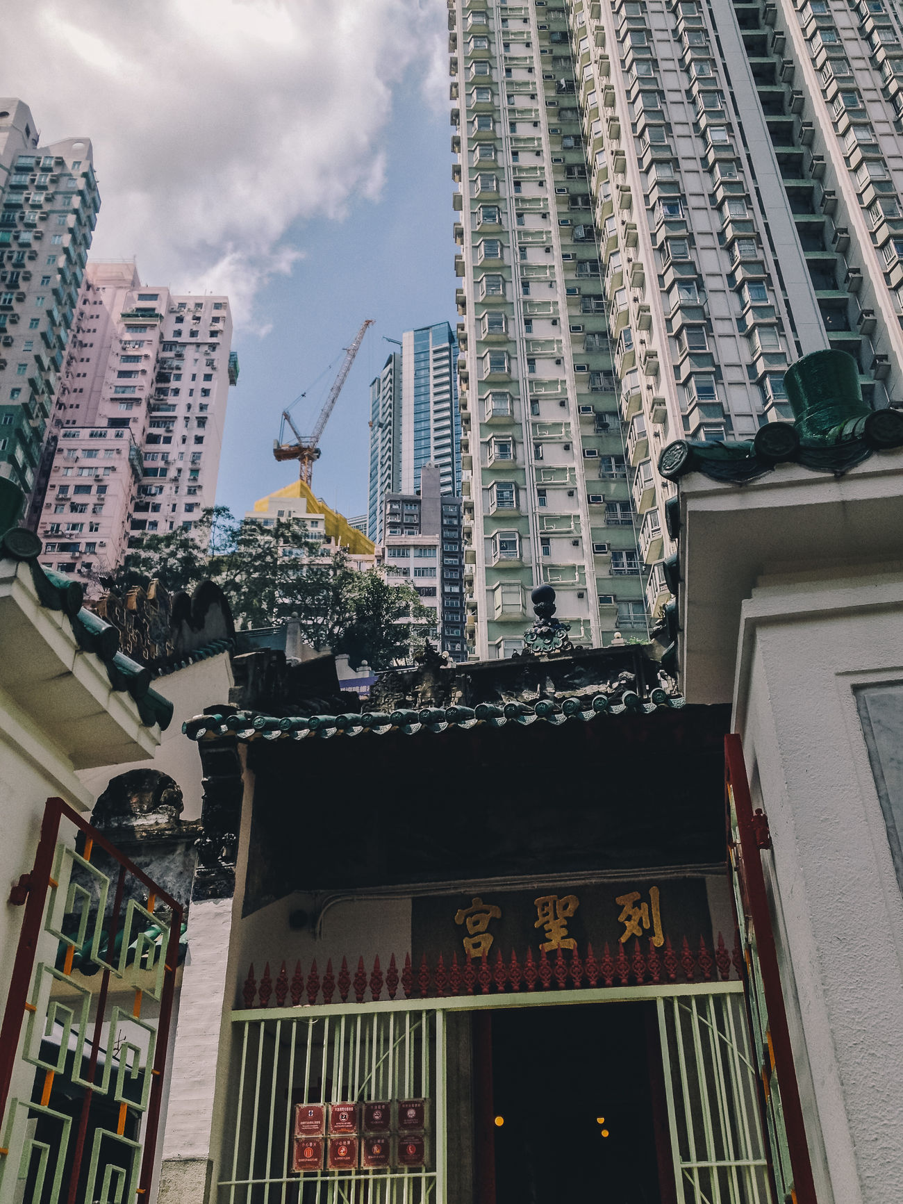 Manmo Temple and Highrises, Hong Kong, May 2013. Apartment Architecture Balance Buddhist Buddhist Temple City City Life Cloud - Sky Construction Density Highrise IPhoneography Low Angle View Mobile Photography Modern Old And New Residential Building Residential Structure Skyscraper Travel Photography Traditional Urban Exploration Urban Geometry Showcase July Travel