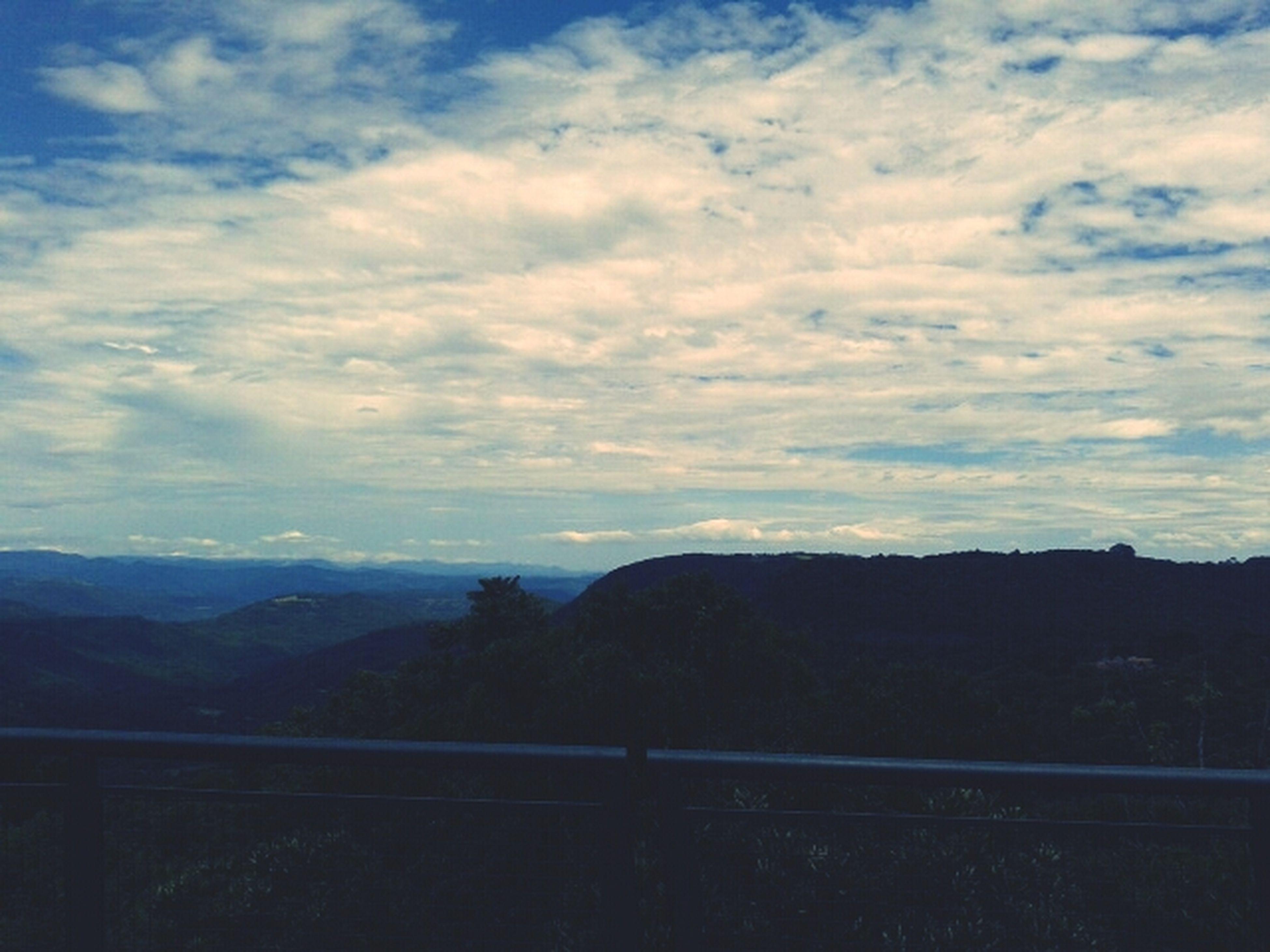 mountain, mountain range, tranquil scene, sky, tranquility, scenics, beauty in nature, cloud - sky, landscape, nature, silhouette, cloud, idyllic, non-urban scene, cloudy, remote, outdoors, no people, dusk, non urban scene