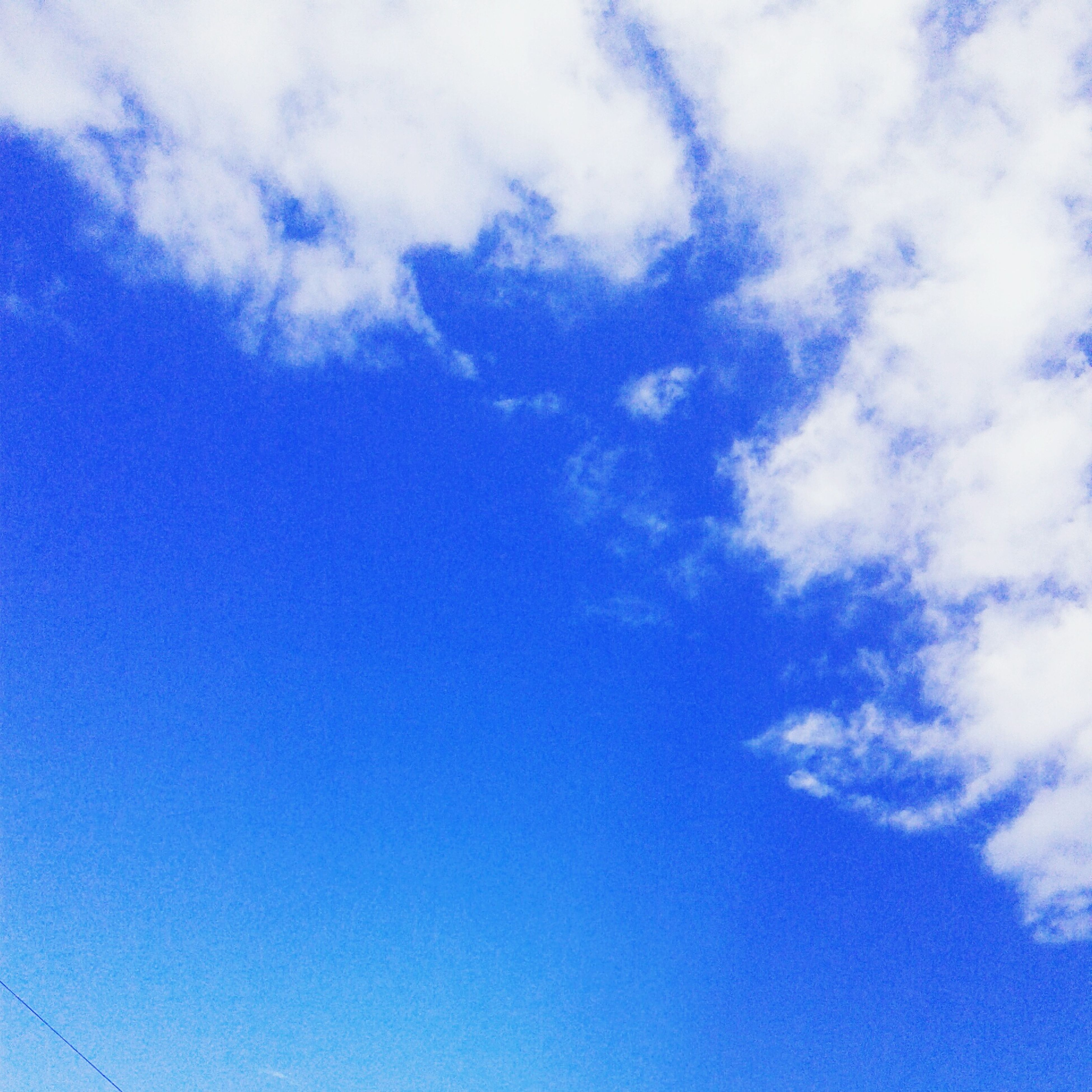 blue, low angle view, sky, beauty in nature, sky only, backgrounds, tranquility, cloud - sky, nature, scenics, white color, full frame, tranquil scene, cloud, day, outdoors, no people, cloudy, idyllic, white