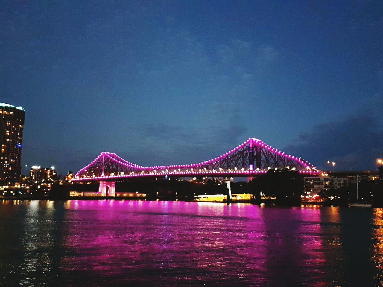 A relaxing night trip along the Brisbane river Bridge - Man Made Structure Storybridge Illuminated Water Architecture River Famous Place City Life Night Brisbane Australia Brisbane River