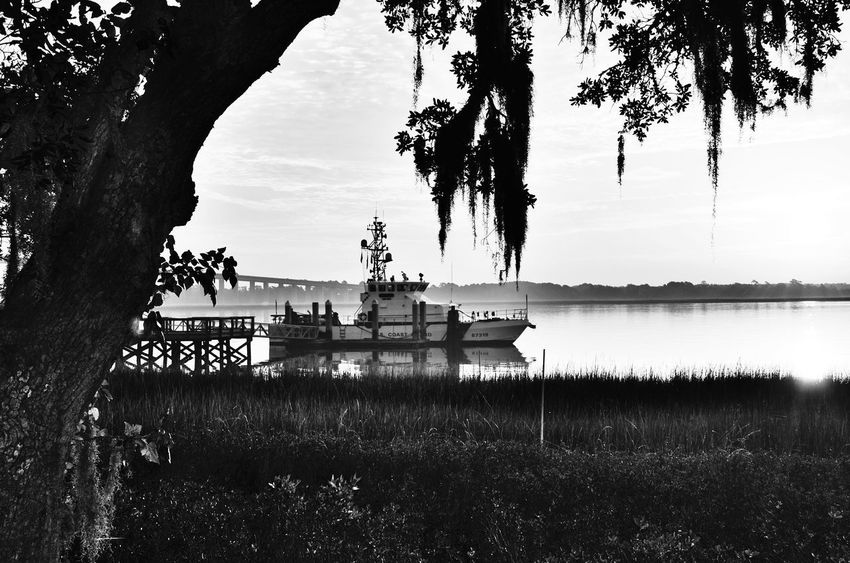 Coastline Landscape Daniel Island, Sc South Carolina Beach South Carolina Coast Guard Coast Guard Ship Coast Guard Boat Blackandwhite Photography Black & White Black&white Black And White Photography Blackandwhite Blackandwhitephotography Black And White Collection  Tranquil Scene Tranquility Morning Silence Pier Water Silhouette Waterfront Lost In The Landscape