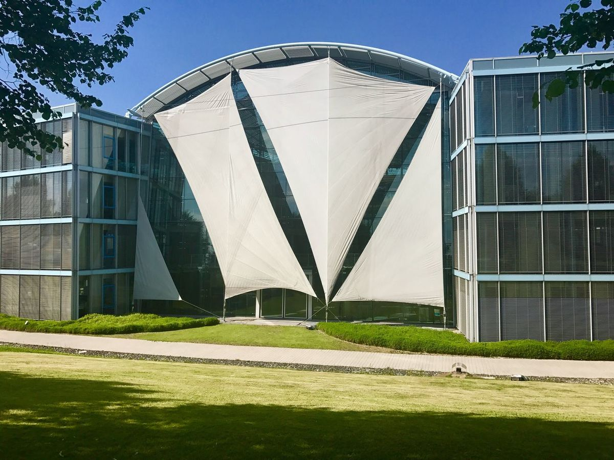 Modern offfice building with sun shields Architecture Built Structure Building Exterior Sunlight Day Lawn Modern Grass Outdoors No People Museum Tree Nature City Sky Sun Sails Sun Shield Sun Shining