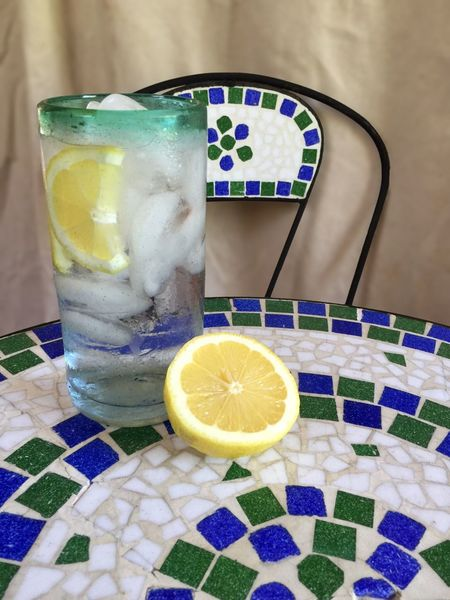 Glass of water with light background Glass Of Water StillLifePhotography Stillife Still Life Photography Still Life Table Top Tile Art Tile Thristy Quenchyourthirst Lemons