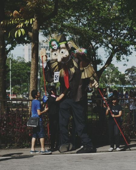 Mask - Disguise Performance Outdoors Teamwork Live For The Story The Great Outdoors - 2017 EyeEm Awards The Street Photographer - 20I7 EyeEm Awards Cooperation Standing Puppet Mascot Mascara Festival Festival Mr. Bean Tall Sunny Bacolod