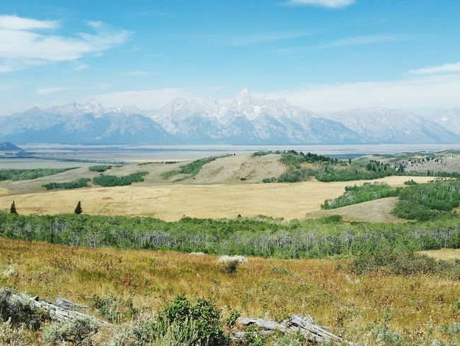 Tetons Wyoming Ranch Life Fields Hills Mountains Sky And Clouds Peaks Sagebrush