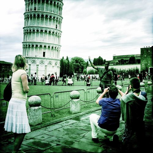 Maybe he can stop it Seeing The Sights Tower Of Pisa Posing Tourists Making Fun with Taking Photos Check This Out Cheese! EyeEm Italy The Tourist