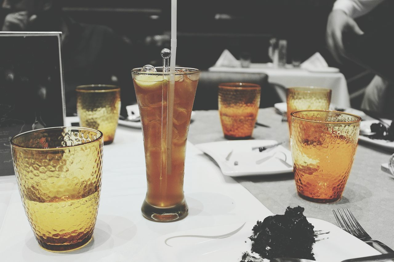 food and drink, drink, drinking glass, refreshment, freshness, table, drinking straw, ice cube, serving size, slice, indoors, cold temperature, indulgence, food, temptation, dessert, iced coffee, close-up, ready-to-eat, sweet food, no people, day