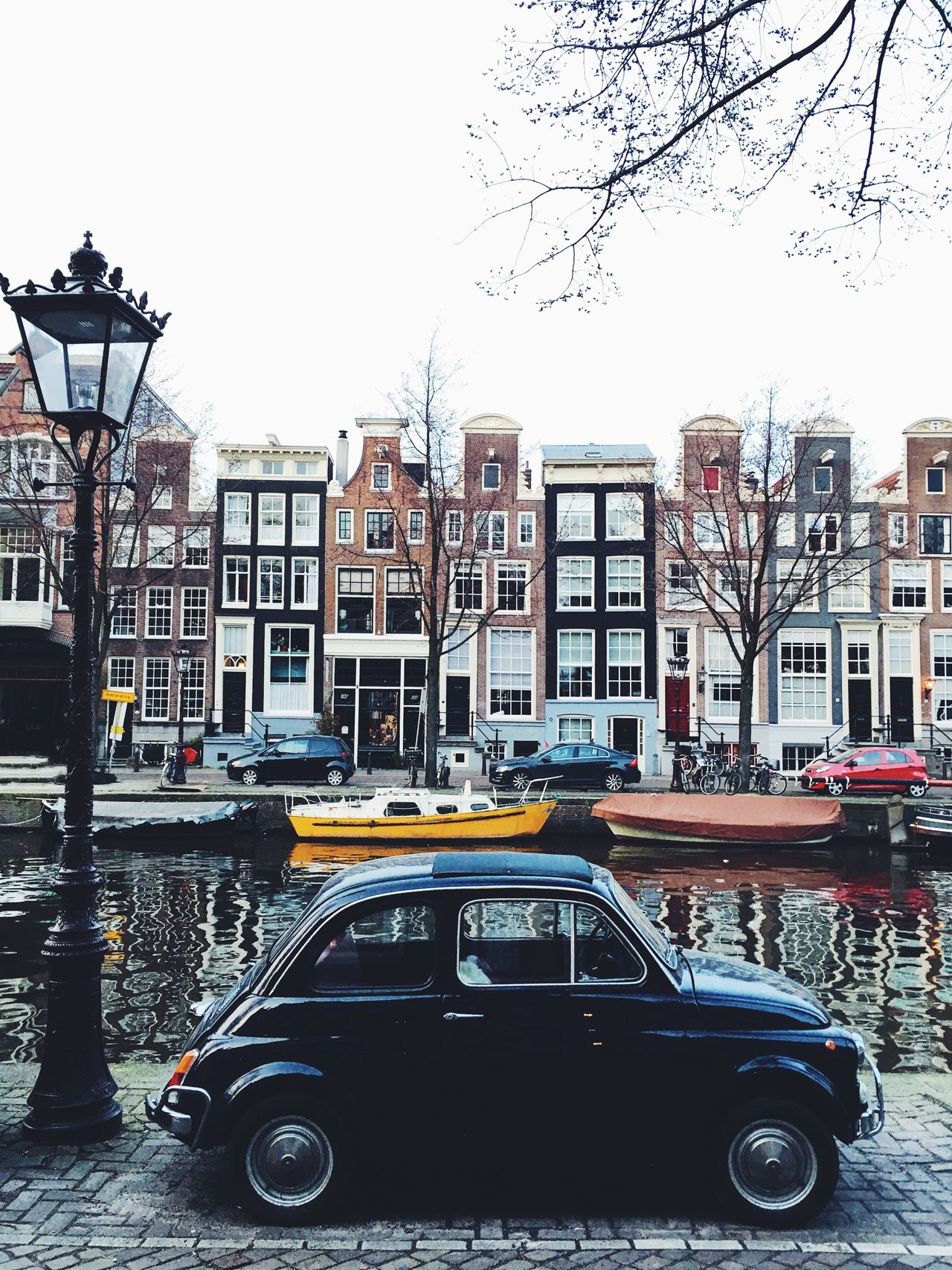 Amsterdam City Street City Street Streetphotography Transportation Architecture Building Exterior City Life Mode Of Transport Car Built Structure Outdoors Travel Destinations Day Cityscape No People Lifestyles Real Photography Architecture Travel City Street Parking