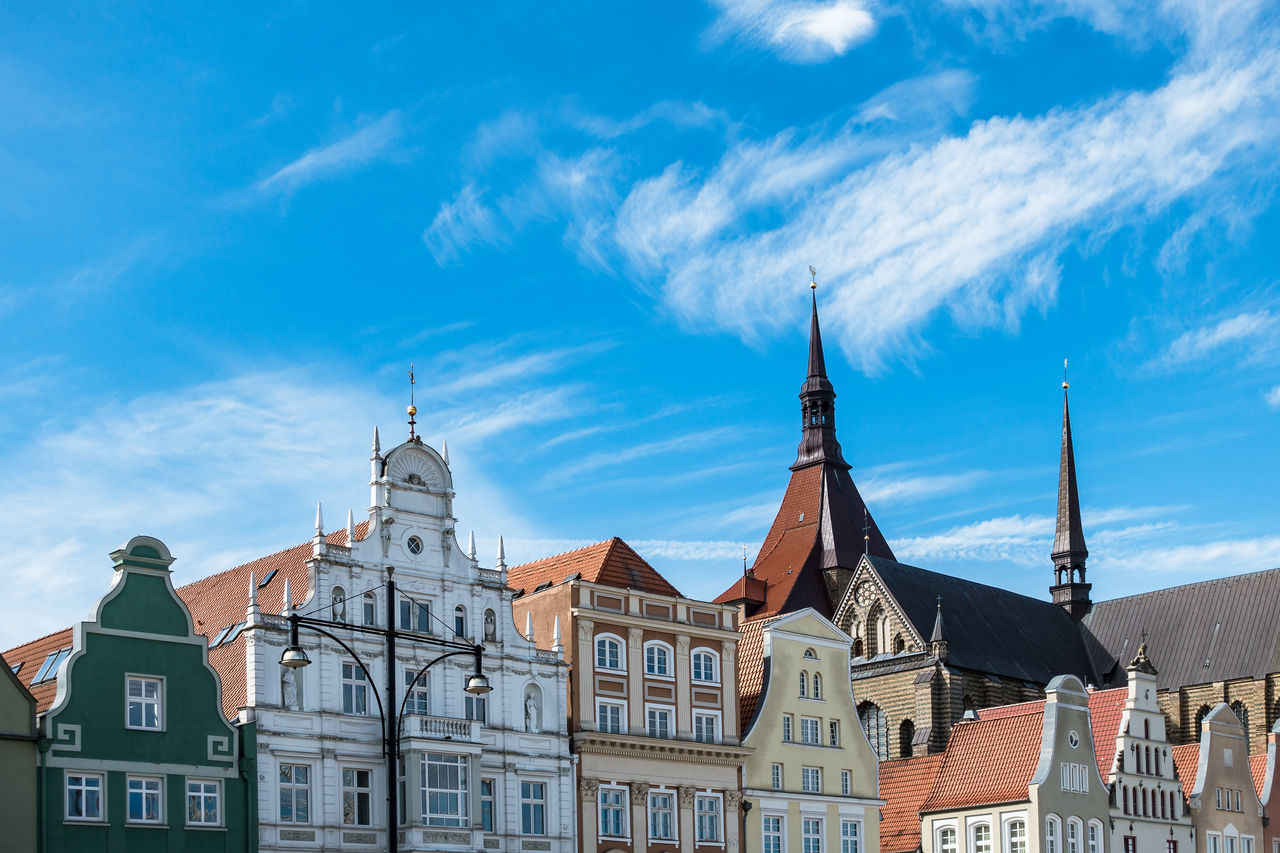 Historical buildings in Rostock, Germany. Architecture Blue Building Exterior Built Structure Church City Cloud - Sky Day History Low Angle View Marienkirche Neuer Markt No People Outdoors Place Of Worship Religion Rostock Sky Spirituality Tourism Town Travel Destinations