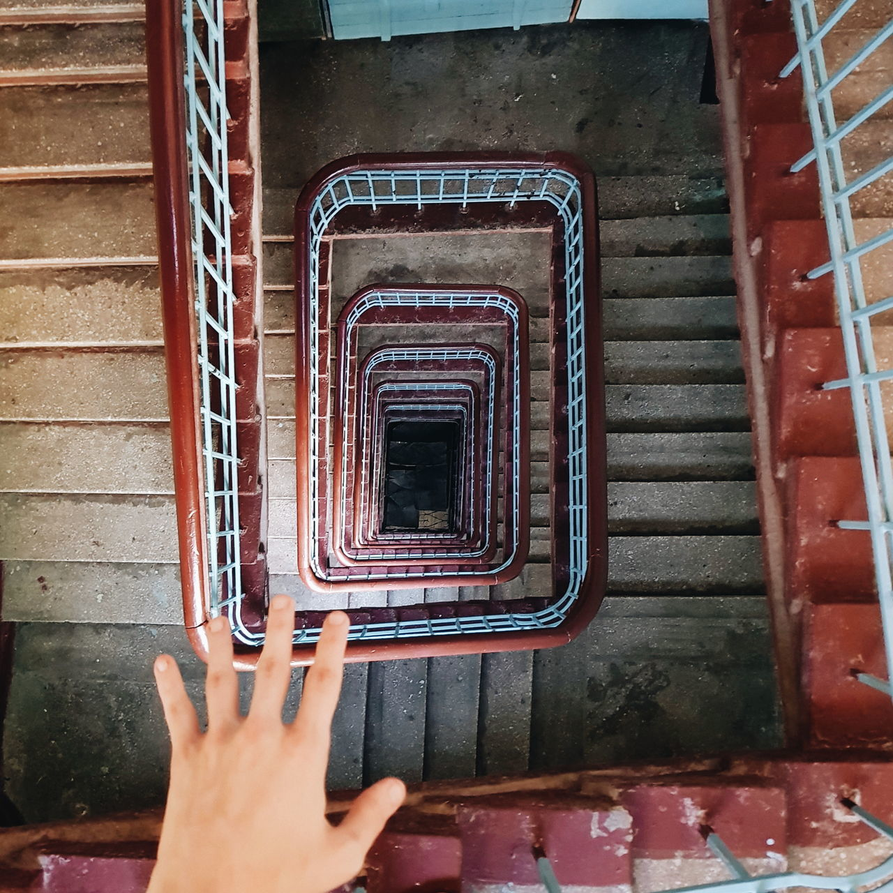 one person, real people, staircase, steps and staircases, steps, human body part, indoors, personal perspective, human hand, stairs, lifestyles, hand rail, day, adult, people, adults only