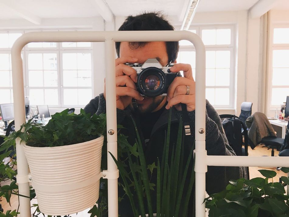 Camera - Photographic Equipment Photography Themes Photographing Photographer One Person Holding Digital Camera Photographic Equipment Indoors  Plant Young Adult