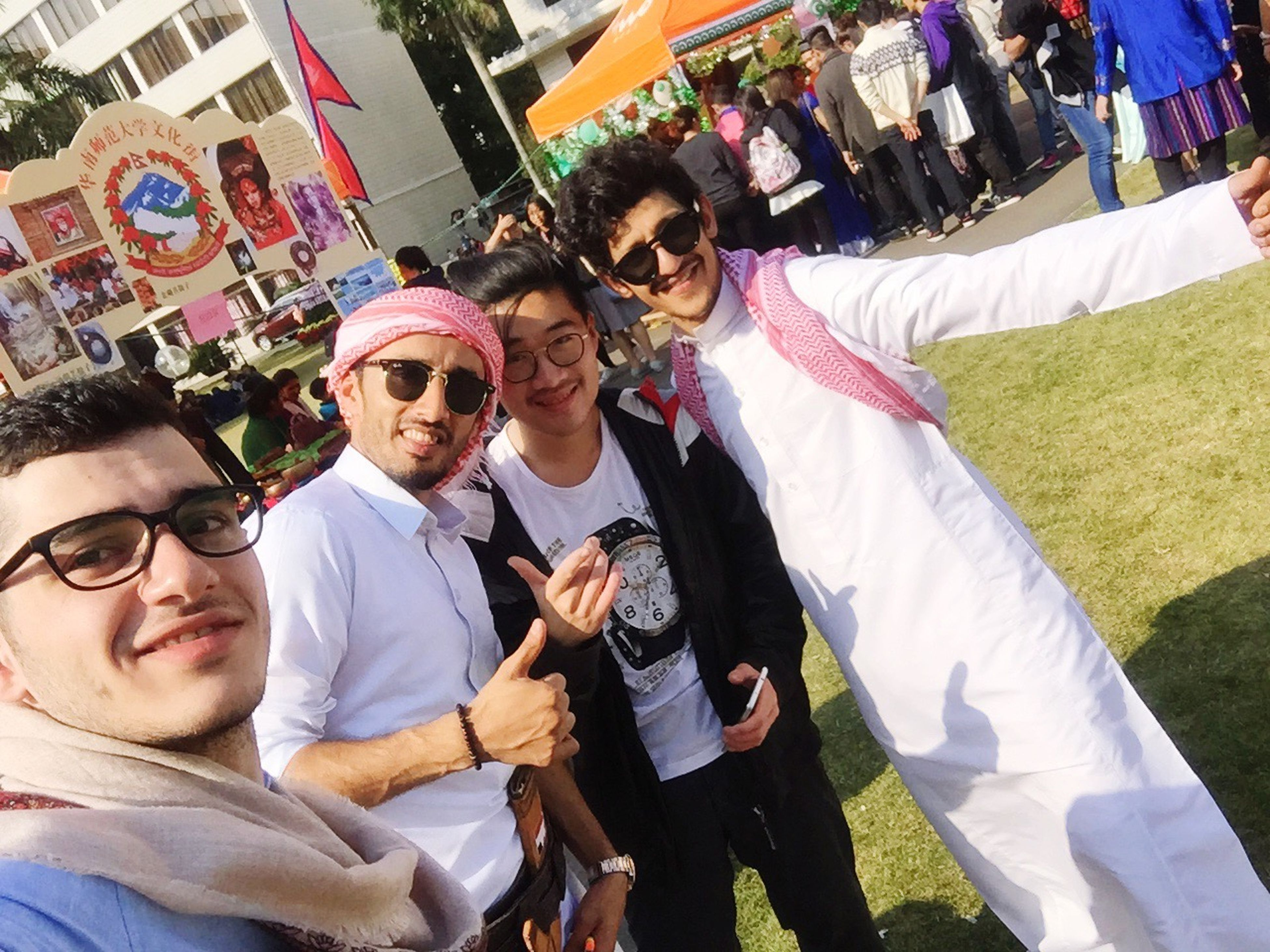 togetherness, smiling, happiness, men, sunglasses, fun, cheerful, multi colored, people, adult, adults only, young adult, outdoors, market, day, only men