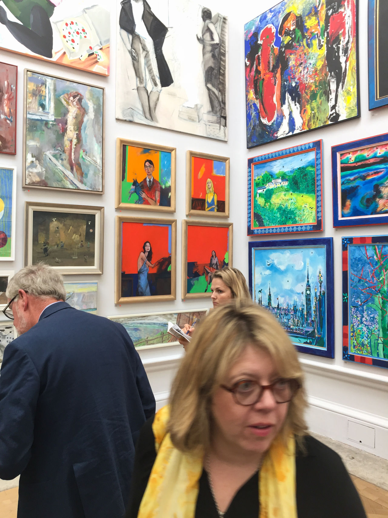 Framed works of art hang at the Royal Academy of Arts in London for the Summer 2017 Exhibition of emerging and established artists. People have come to view the show and purchase the pieces on display. Framed London Royal Academy Of Arts Show Art Editorial  Eyeglasses  Gallery Indoors  Men Painting People Real People Women Young Women