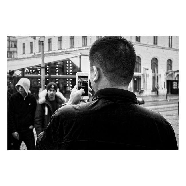 - I, photo. Photography Themes Real People Photographing Technology Lifestyles Built Structure Architecture Men Rear View Building Exterior Leisure Activity Screen Day Streetphotography Blackandwhite Streetphoto Outdoors Adult