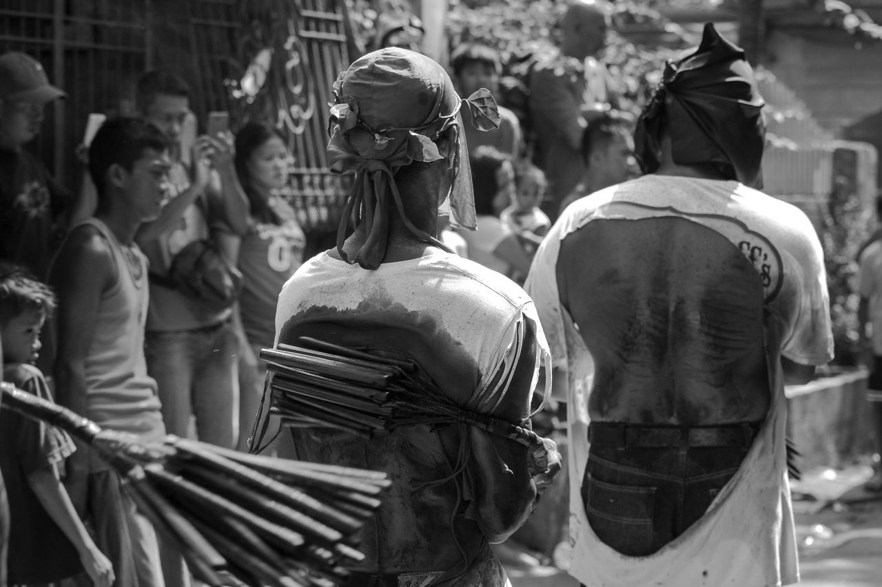 Faith hurts. Self-flagellation has become a tradition during Good Friday of lent in this part of Cavite, Philippines. Bare Back Culture Faith Good Friday Hurt Incidental People Lent Men Penitent Person Self-flagellation Tradition Travel