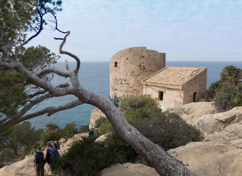 Adult Adults Only Architecture Day Horizon Over Water Hulk Mallorca Mediterranean Sea Old Buildings Outdoors People Rocks Ruins Sea SPAIN Torre Torre D'en Basset Tower Tree Tree Watch Tower Water