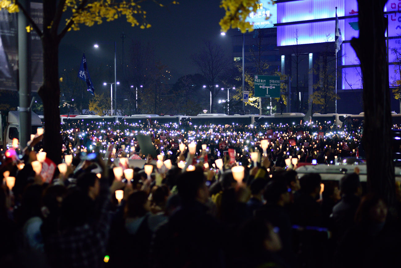 Koreans try to cure the democracy in Korea Candle Light Crowd For Korean Democracy Large Group Of People