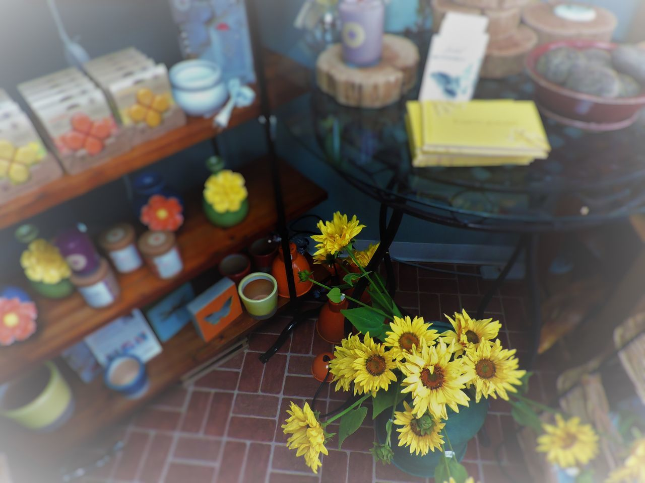 flower, high angle view, table, freshness, indoors, no people, yellow, day, close-up, food, sweet food, fragility, ready-to-eat, flower head