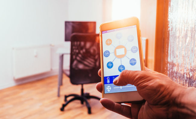 Adjusting the room temperature with smart home home automation system App Automation Automations Communication Control Device Electronics  Hand Heating Home House Human Management Mobile Modern Monitoring Phone Smart Smart Home Smart Phone Technology Temperature